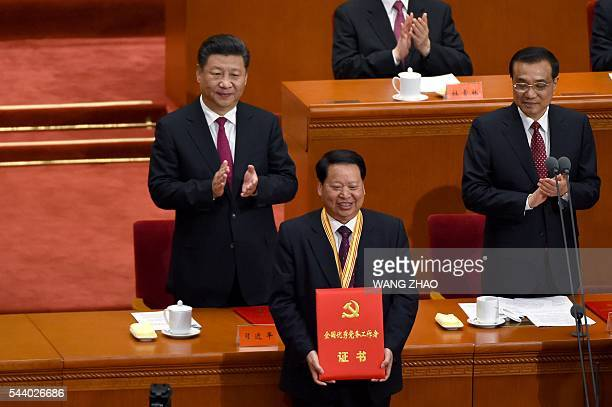 Chinese President Xi Jinping and Chinese Premier Li Keqiang applaud after honouring communist party member duringThe Celebration Ceremony of the 95th...