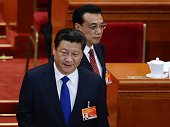 Chinese president Xi Jinping and Chinese premier Li Keqiang arrive for the opening of the 3rd Session of the 12th National People's Congress at the...
