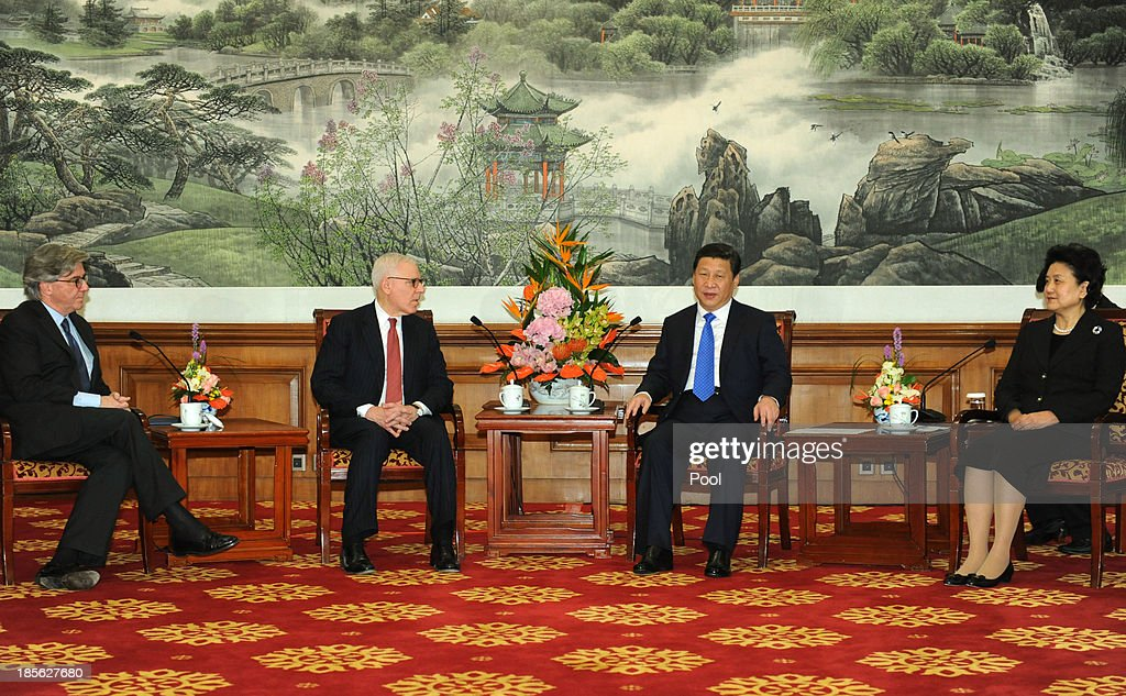 Chinese President Xi Jinping (2nd R) and Chinese Vice Premier Liu Yandong (R) attend a meeting with David Rubenstein, the Chair of advisory board (2nd L) and other advisory board entrepreneurs from Tsinghua School of Economics and Management at the Diaoyutai State Guesthouse on October 23, 2013 in Beijing, China.