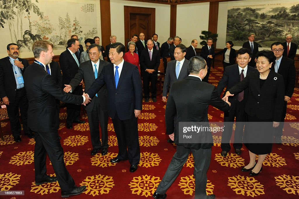 Chinese President Xi Jinping (5th L) and Chinese Vice Premier Liu Yandong (3rd R) attend a meeting with the advisory board entrepreneurs from Tsinghua School of Economics and Management at the Diaoyutai State Guesthouse on October 23, 2013 in Beijing, China.