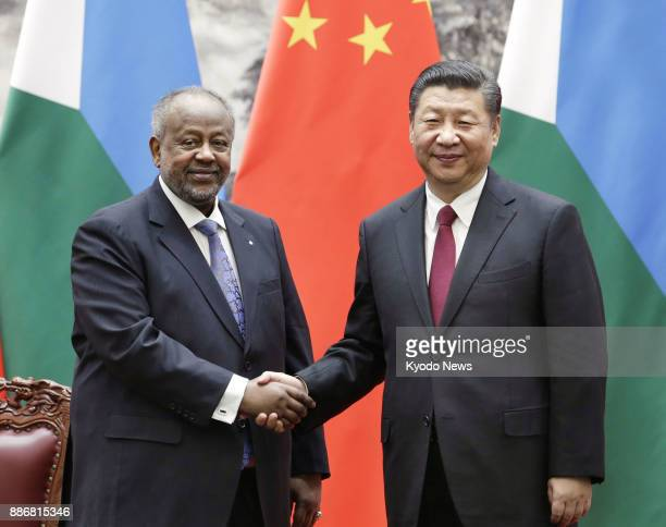 Chinese President Xi Jinping and Djibouti President Ismail Omar Guelleh shake hands in Beijing in this file photo taken in November 2017 ==Kyodo