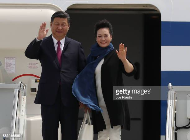 Chinese President Xi Jinping and first lady Peng Liyuan arrive at Palm Beach International Airport April 6 2017 in West Palm Beach Florida President...