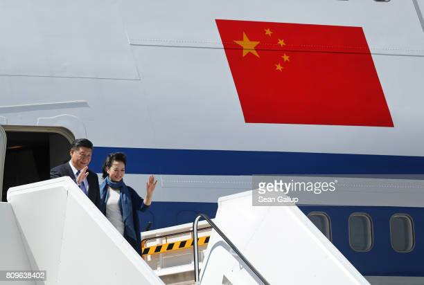 Chinese President Xi Jinping and First Lady Peng Liyuan arrive at Hamburg Airport for the Hamburg G20 economic summit on July 6 2017 in Hamburg...