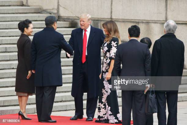 Chinese President Xi Jinping and first lady Peng Liyuan greets US President Donald Trump and first lady Melania Trump at a welcoming ceremony...
