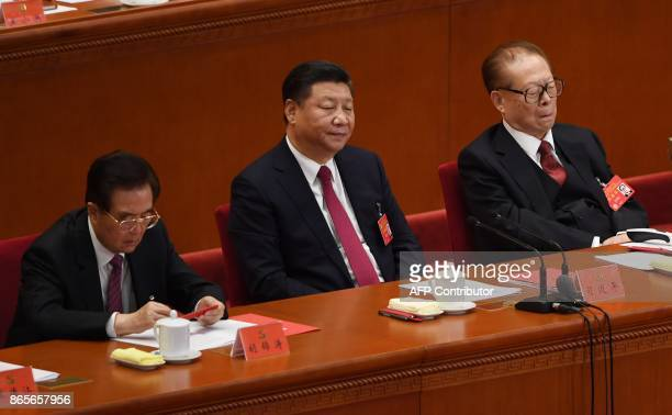 Chinese President Xi Jinping and former presidents Jiang Zemin and Hu Jintao attend the closing of the 19th Communist Party Congress at the Great...