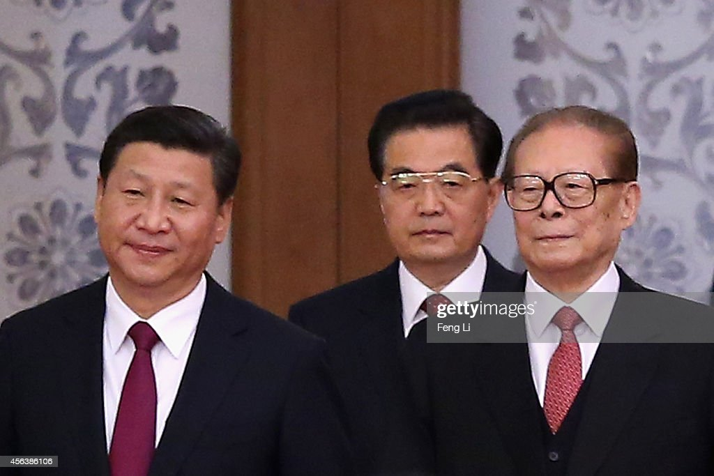 Chinese President <a gi-track='captionPersonalityLinkClicked' href=/galleries/search?phrase=Xi+Jinping&family=editorial&specificpeople=2598986 ng-click='$event.stopPropagation()'>Xi Jinping</a> and his predecessors <a gi-track='captionPersonalityLinkClicked' href=/galleries/search?phrase=Hu+Jintao&family=editorial&specificpeople=203109 ng-click='$event.stopPropagation()'>Hu Jintao</a> and <a gi-track='captionPersonalityLinkClicked' href=/galleries/search?phrase=Jiang+Zemin&family=editorial&specificpeople=159399 ng-click='$event.stopPropagation()'>Jiang Zemin</a> arrive for the National Day reception marking the 65th anniversary of the founding of the People's Republic of China at The Great Hall Of The People on September 30, 2014 in Beijing, China. China celebrates its 65th founding anniversary on October 1, which marks the beginning of the Golden Week National Day holidays.