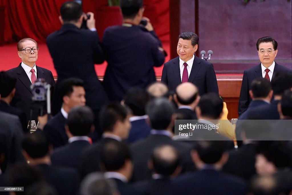 Chinese President Xi Jinping and his predecessors Hu Jintao and Jiang Zemin arrive for the National Day reception marking the 65th anniversary of the...