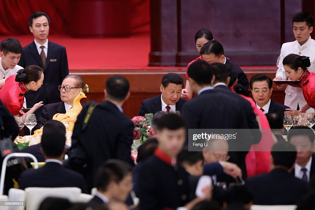 Chinese President Xi Jinping and his predecessors Hu Jintao and Jiang Zemin attend the National Day reception marking the 65th anniversary of the...