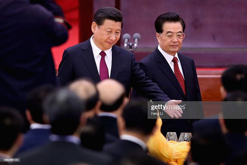 Chinese President <a gi-track='captionPersonalityLinkClicked' href=/galleries/search?phrase=Xi+Jinping&family=editorial&specificpeople=2598986 ng-click='$event.stopPropagation()'>Xi Jinping</a> (L) and his predecessors <a gi-track='captionPersonalityLinkClicked' href=/galleries/search?phrase=Hu+Jintao&family=editorial&specificpeople=203109 ng-click='$event.stopPropagation()'>Hu Jintao</a> (R) arrive for the National Day reception marking the 65th anniversary of the founding of the People's Republic of China at The Great Hall Of The People on September 30, 2014 in Beijing, China. China celebrates its 65th founding anniversary on October 1, which marks the beginning of the Golden Week National Day holidays.