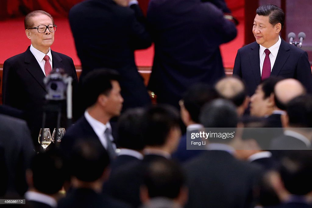 Chinese President Xi Jinping and his predecessors Jiang Zemin arrive for the National Day reception marking the 65th anniversary of the founding of...