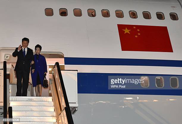 Chinese President Xi Jinping and his wife Peng Liyuan arrive for a fourday state visit at Heathrow Airport on October 19 2015 in London England In...