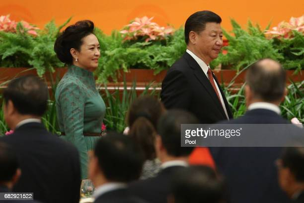 Chinese President Xi Jinping and his wife Peng Liyuan arrive for a welcome banquet for the Belt and Road Forum at the Great Hall of the People in...