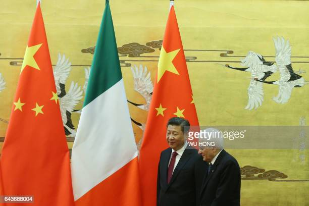 Chinese President Xi Jinping and Italian President Sergio Mattarella arrive for a signing ceremony at the Great Hall of the People in Beijing on...