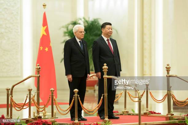 Chinese President Xi Jinping and Italian President Sergio Mattarella listen to their national anthems during a welcoming ceremony inside the Great...