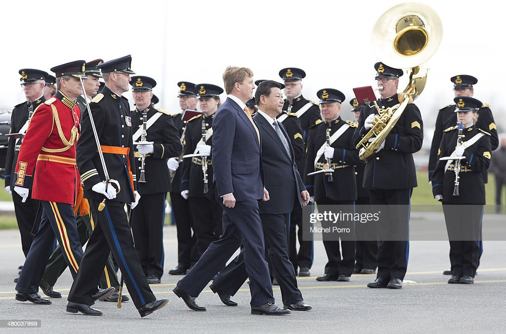 Chinese President Xi Jinping (centre, right) and King Willem-Alexander of The Netherlands review the honour guard upon Xi's arrival at Schiphol International Airport on March 22, 2014 in Amsterdam, Netherlands. Xi Jinping is on a two-day state visit to the Netherlands ahead of the 2014 Nuclear Security Summit (NSS) in The Hague, which will be held on March 24-25.