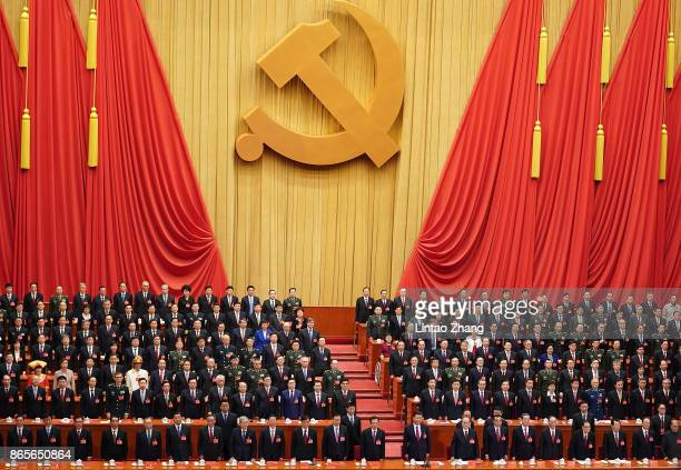 Chinese President Xi Jinping and other Chinese politicians and delegates listen to the national anthem duirng the closing of the 19th Communist Party...
