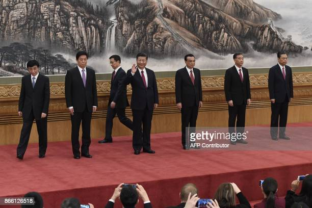 Chinese President Xi Jinping and other new members of the Communist Party of China's Politburo Standing Committee Wang Huning Li ZhanshuHan Zheng Li...
