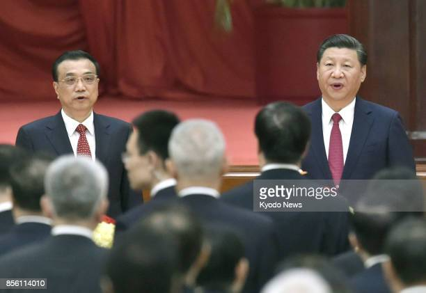 Chinese President Xi Jinping and Premier Li Keqiang attend a reception to celebrate National Day in the Great Hall of the People in Beijing on Sept...