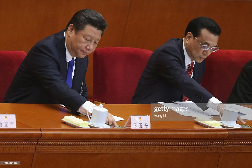 Chinese President <a gi-track='captionPersonalityLinkClicked' href=/galleries/search?phrase=Xi+Jinping&family=editorial&specificpeople=2598986 ng-click='$event.stopPropagation()'>Xi Jinping</a> (Left) and Premier <a gi-track='captionPersonalityLinkClicked' href=/galleries/search?phrase=Li+Keqiang&family=editorial&specificpeople=2481781 ng-click='$event.stopPropagation()'>Li Keqiang</a> (Right) press buttons to vote on the results of the work reports during the closing ceremony of China's National People's Congress (NPC) at the Great Hall of the People on March 15, 2015 in Beijing, China. China's national legislators adopted a revision to the Legislation Law Sunday.