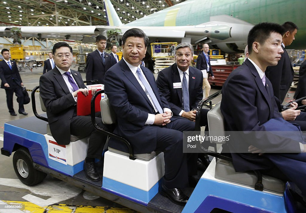 Chinese President Xi Jinping (3rd L) and Ray Conner (2nd L), president and CEO Boeing Commercial Airplanes, tour the Boeing assembly line on September 23, 2015, in Seattle, Washington. The Paulson Institute, in partnership with the China Council for the Promotion of International Trade, co-hosted the event.