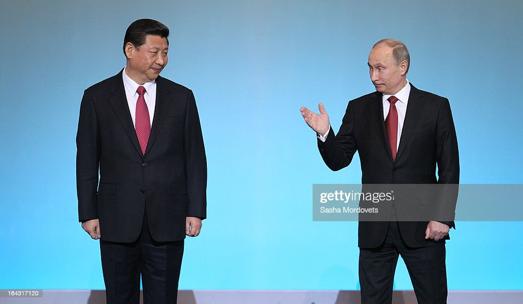 Chinese President <a gi-track='captionPersonalityLinkClicked' href=/galleries/search?phrase=Xi+Jinping&family=editorial&specificpeople=2598986 ng-click='$event.stopPropagation()'>Xi Jinping</a> (L) and Russian President <a gi-track='captionPersonalityLinkClicked' href=/galleries/search?phrase=Vladimir+Putin&family=editorial&specificpeople=154896 ng-click='$event.stopPropagation()'>Vladimir Putin</a> attend a concert in the Kremlin on March 22, 2013 in Moscow, Russia. President <a gi-track='captionPersonalityLinkClicked' href=/galleries/search?phrase=Xi+Jinping&family=editorial&specificpeople=2598986 ng-click='$event.stopPropagation()'>Xi Jinping</a>'s visit to Russia is his first overseas trip as president.