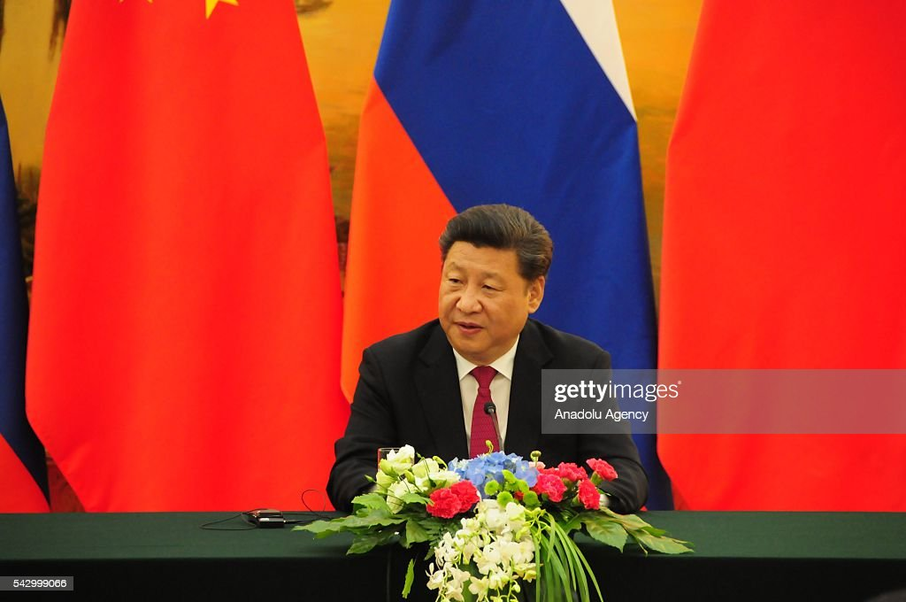 Chinese President Xi Jinping (C) and Russian President Vladimir Putin (not seen) hold a joint press conference after their meeting and signing ceremony in Beijing, China on June 25, 2016.
