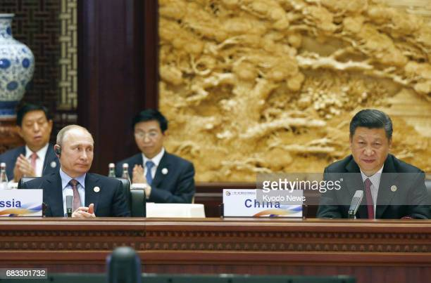 Chinese President Xi Jinping and Russian President Vladimir Putin attend a summit at the Belt and Road Forum for International Cooperation in Beijing...