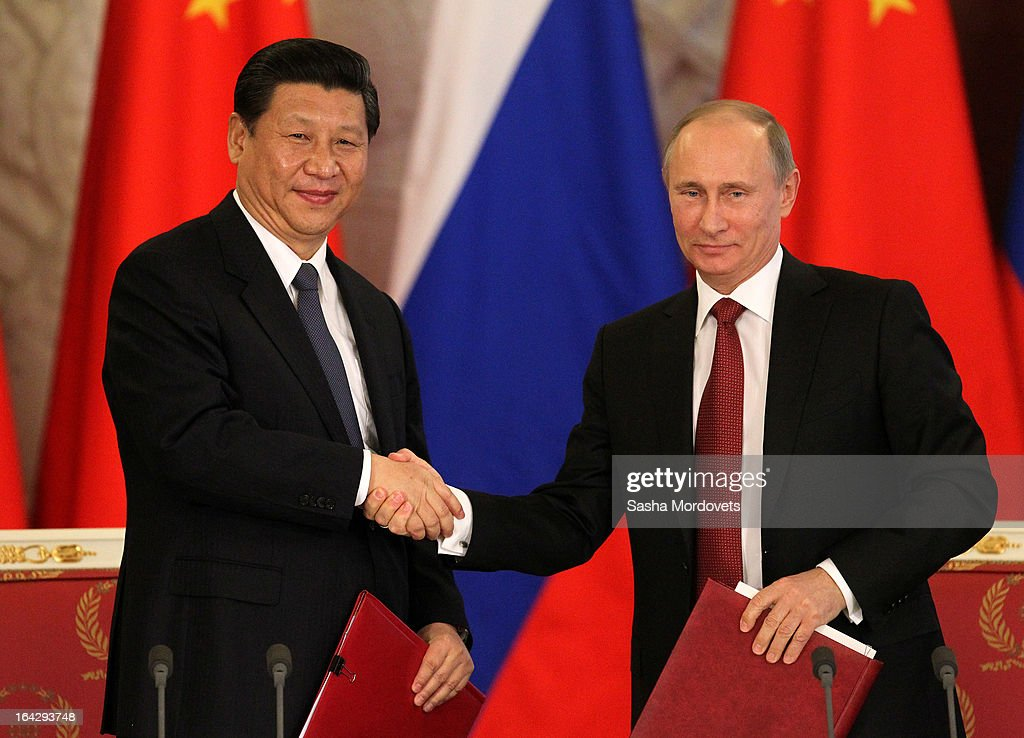 Chinese President <a gi-track='captionPersonalityLinkClicked' href=/galleries/search?phrase=Xi+Jinping&family=editorial&specificpeople=2598986 ng-click='$event.stopPropagation()'>Xi Jinping</a> (L) and Russian President <a gi-track='captionPersonalityLinkClicked' href=/galleries/search?phrase=Vladimir+Putin&family=editorial&specificpeople=154896 ng-click='$event.stopPropagation()'>Vladimir Putin</a> meet in Moscow's Grand Kremlin Palace on March 22, 2013 in Moscow, Russia. President <a gi-track='captionPersonalityLinkClicked' href=/galleries/search?phrase=Xi+Jinping&family=editorial&specificpeople=2598986 ng-click='$event.stopPropagation()'>Xi Jinping</a>'s visit to Russia is his first overseas trip as president.