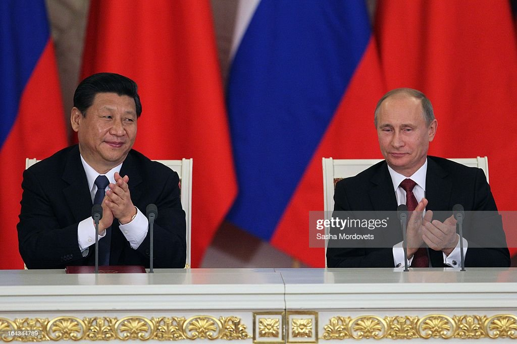 Chinese President <a gi-track='captionPersonalityLinkClicked' href=/galleries/search?phrase=Xi+Jinping&family=editorial&specificpeople=2598986 ng-click='$event.stopPropagation()'>Xi Jinping</a> (L) and Russian President <a gi-track='captionPersonalityLinkClicked' href=/galleries/search?phrase=Vladimir+Putin&family=editorial&specificpeople=154896 ng-click='$event.stopPropagation()'>Vladimir Putin</a> meet in the Grand Kremlin Palace March 22, 2013 in Moscow, Russia, Xi is making his first foreign visit as China's leader in a move described as demonstrating the two countries' economic interdependence.