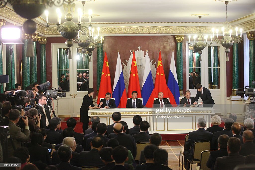 Chinese President <a gi-track='captionPersonalityLinkClicked' href=/galleries/search?phrase=Xi+Jinping&family=editorial&specificpeople=2598986 ng-click='$event.stopPropagation()'>Xi Jinping</a> (Center, L) and Russian President <a gi-track='captionPersonalityLinkClicked' href=/galleries/search?phrase=Vladimir+Putin&family=editorial&specificpeople=154896 ng-click='$event.stopPropagation()'>Vladimir Putin</a> (Center, R) meet in the Grand Kremlin Palace March 22, 2013 in Moscow, Russia, Xi is making his first foreign visit as China's leader in a move described as demonstrating the two countries' economic interdependence.