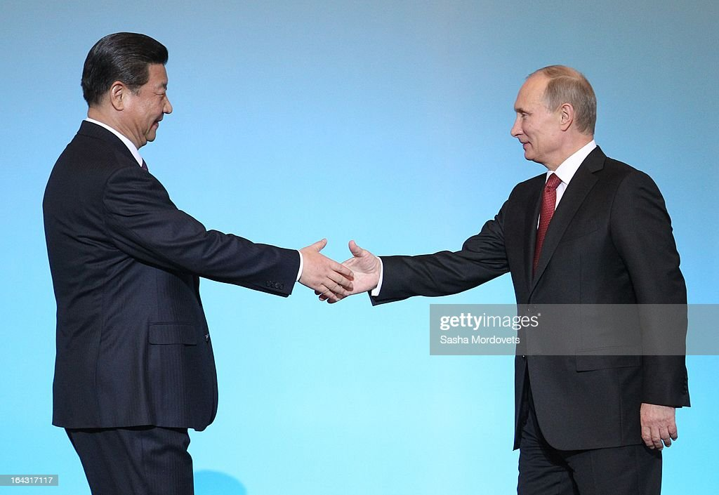 Chinese President <a gi-track='captionPersonalityLinkClicked' href=/galleries/search?phrase=Xi+Jinping&family=editorial&specificpeople=2598986 ng-click='$event.stopPropagation()'>Xi Jinping</a> (L) and Russian President <a gi-track='captionPersonalityLinkClicked' href=/galleries/search?phrase=Vladimir+Putin&family=editorial&specificpeople=154896 ng-click='$event.stopPropagation()'>Vladimir Putin</a> shake hands at a concert in the Kremlin on March 22, 2013 in Moscow, Russia. President <a gi-track='captionPersonalityLinkClicked' href=/galleries/search?phrase=Xi+Jinping&family=editorial&specificpeople=2598986 ng-click='$event.stopPropagation()'>Xi Jinping</a>'s visit to Russia is his first overseas trip as president.