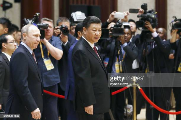 Chinese President Xi Jinping and Russian President Vladimir Putin head to a summit at the Belt and Road Forum for International Cooperation in...