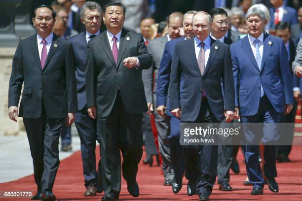 Chinese President Xi Jinping and Russian President Vladimir Putin head to a group photo session along with other leaders and delegates at the Belt...