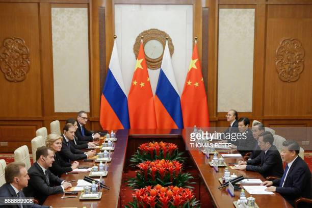 Chinese President Xi Jinping and Russian Prime Minister Dmitry Medvedev talk at the Diaoyutai state guesthouse in Beijing on November 1 2017 / AFP...