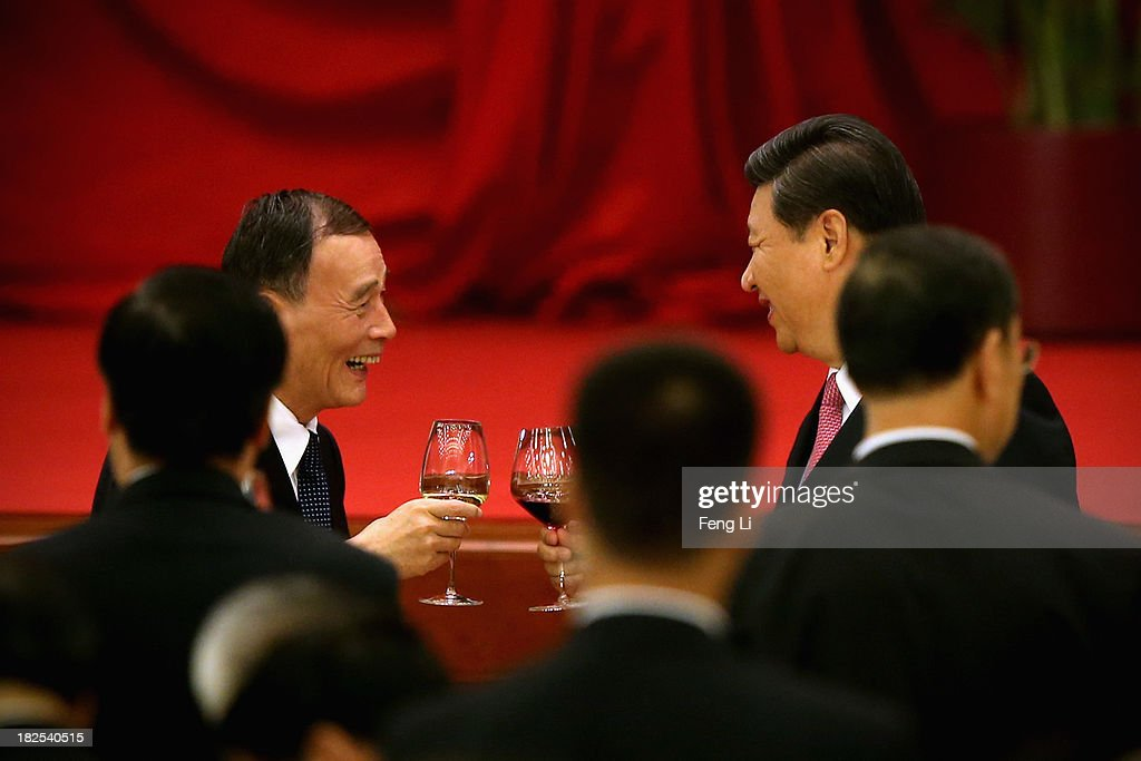 Chinese President <a gi-track='captionPersonalityLinkClicked' href=/galleries/search?phrase=Xi+Jinping&family=editorial&specificpeople=2598986 ng-click='$event.stopPropagation()'>Xi Jinping</a> (Right) and Secretary of the Central Commission for Discipline Inspection <a gi-track='captionPersonalityLinkClicked' href=/galleries/search?phrase=Wang+Qishan&family=editorial&specificpeople=692964 ng-click='$event.stopPropagation()'>Wang Qishan</a> toast with high-ranking Chinese officials at a dinner marking the 64th anniversary of the founding of the People's Republic of China at the Great Hall of the People on September 30, 2013 in Beijing, China. On October 1, 1949, Chinese leader Mao Zedong stood at the Tiananmen Rostrum to declare the founding of the People's Republic of China.