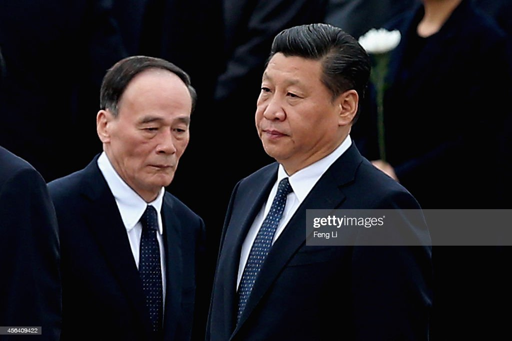 Chinese President <a gi-track='captionPersonalityLinkClicked' href=/galleries/search?phrase=Xi+Jinping&family=editorial&specificpeople=2598986 ng-click='$event.stopPropagation()'>Xi Jinping</a> (R) and Secretary of the Central Commission for Discipline Inspection <a gi-track='captionPersonalityLinkClicked' href=/galleries/search?phrase=Wang+Qishan&family=editorial&specificpeople=692964 ng-click='$event.stopPropagation()'>Wang Qishan</a> (L) arrive the Monument to the People's Heroes during a ceremony marking Martyr(degrees)¯s Day at Tiananmen Square on September 30, 2014 in Beijing, China. China's top legislature approved September 30 as the Martyrs' Day last month.
