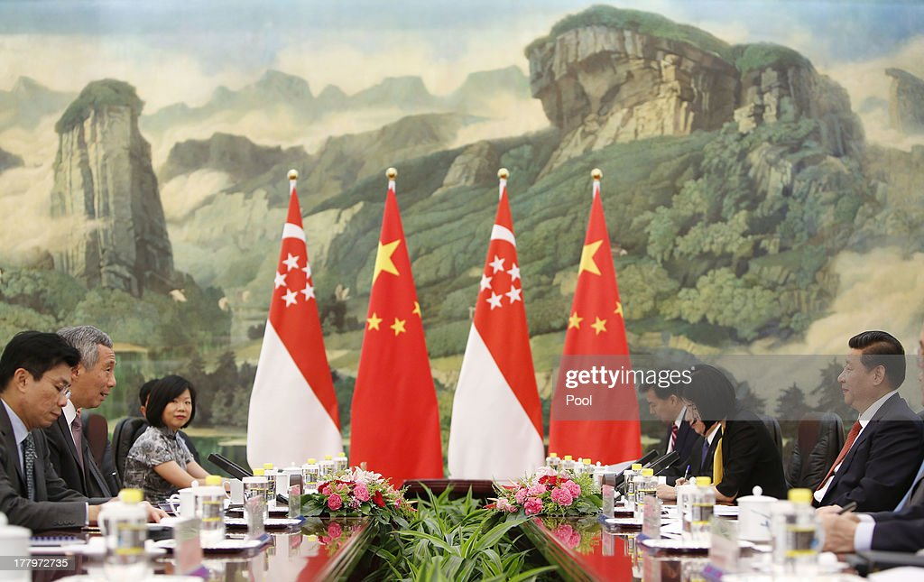 Chinese President <a gi-track='captionPersonalityLinkClicked' href=/galleries/search?phrase=Xi+Jinping&family=editorial&specificpeople=2598986 ng-click='$event.stopPropagation()'>Xi Jinping</a> (R) and Singapore's Prime Minister <a gi-track='captionPersonalityLinkClicked' href=/galleries/search?phrase=Lee+Hsien+Loong&family=editorial&specificpeople=3911578 ng-click='$event.stopPropagation()'>Lee Hsien Loong</a> (2-L) are seen during their meeting at the Great Hall of the People on August 26, 2013 in Beijing, China. Lee is on a seven-day visit to China where he will also visit China's Xinjiang Uygur Autonomous Region and Liaoning Province.