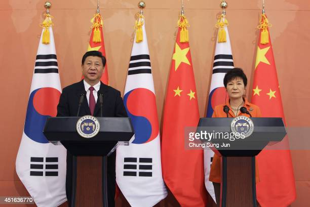 Chinese President Xi Jinping and South Korean President Park GeunHye attend a joint press conference held at the presidential Blue House on July 3...