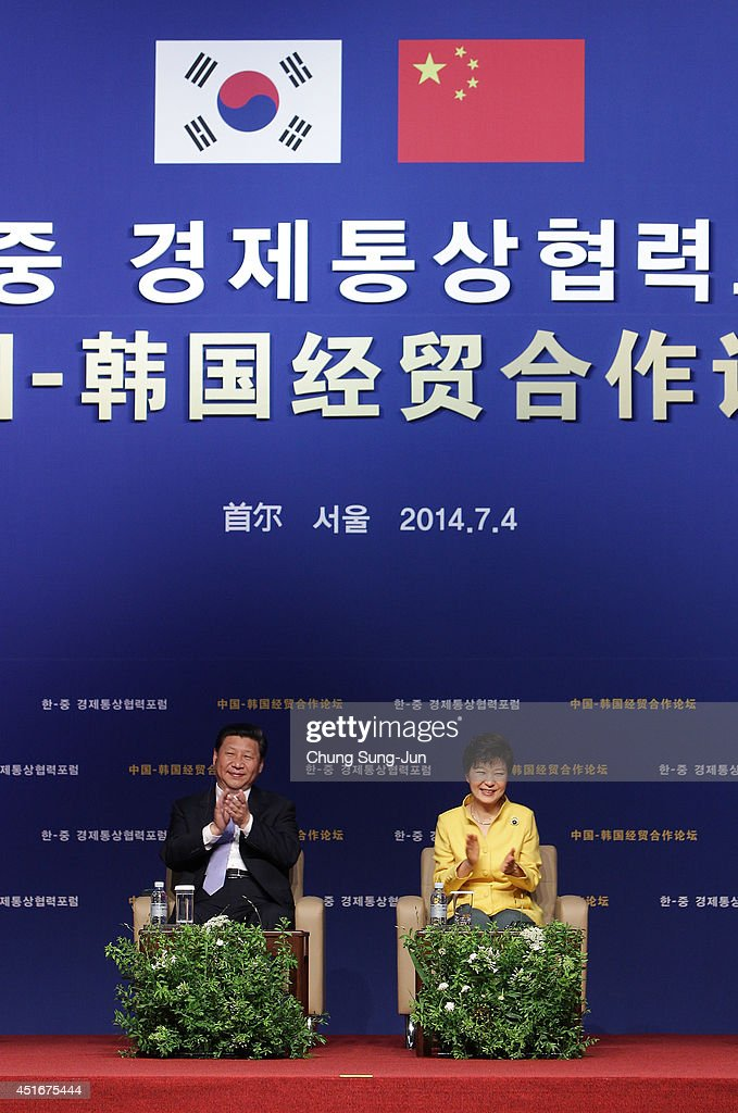 Chinese President Xi Jinping and South Korean President Park GeunHye attend the KoreaChina Investment Forum at Shilla Hotel on July 4 2014 in Seoul...