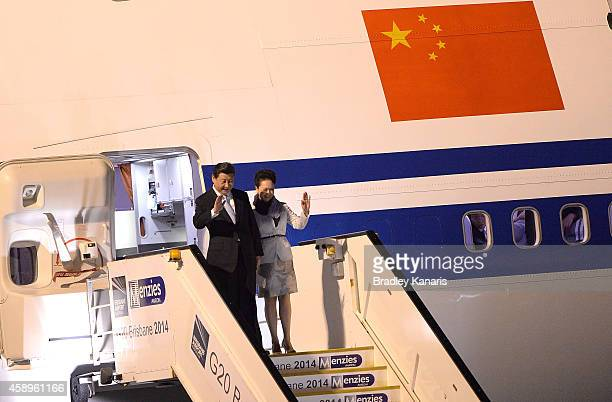 Chinese President Xi Jinping and spouse Peng Liyuan arrive at the G20 international airport on November 14 2014 in Brisbane Australia World leaders...