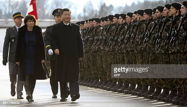 Chinese President Xi Jinping and Swiss President Doris Leuthard review the guard of honour of the Swiss Army during a welcome ceremony upon his...
