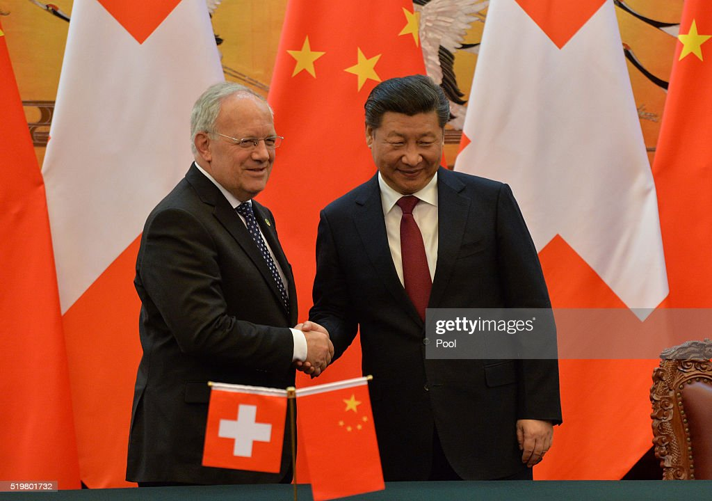 Chinese President Xi Jinping and Swiss President Johann Schneider Amman shakes hands after a signing ceremony at the Great Hall of the People on...