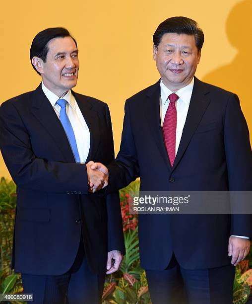 Chinese President Xi Jinping and Taiwan President Ma Yingjeou shake hands before their meeting at Shangrila hotel in Singapore on November 7 2015 The...