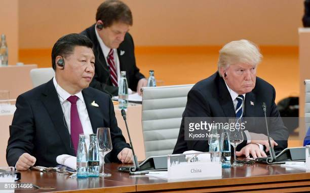 Chinese President Xi Jinping and US President Donald Trump attend a Group of 20 summit meeting in Hamburg Germany on July 7 2017 The G20 leaders...