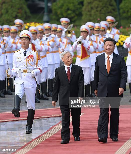 Chinese president Xi Jinping and Vietnamese Communist Party Secretary General Nguyen Phu Trong review an honour guard during a welcoming ceremony at...