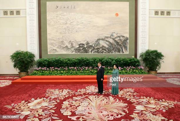 Chinese President Xi Jinping and wife Peng Liyuan wait for guests at the welcoming banquet for the Belt and Road Forum on May 13 2017 in Beijing China