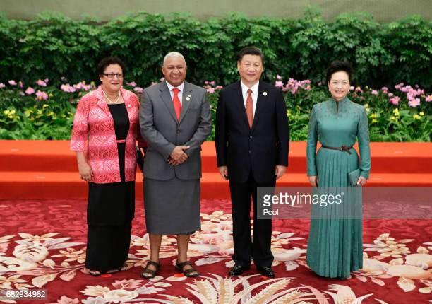Chinese President Xi Jinping and wife Peng Liyuan welcome Fiji's Prime Minister Josaia Voreqe Bainimarama and his wife Maria Makitalena at the...