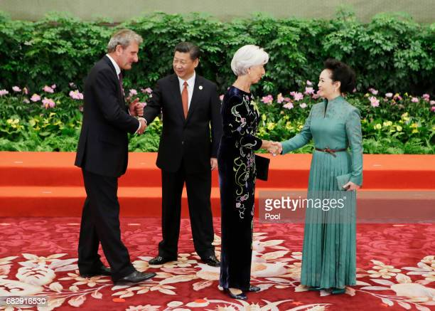 Chinese President Xi Jinping and wife Peng Liyuan welcome IMF Managing Director Christine Lagarde and her husband Xavier Giocanti at the welcoming...