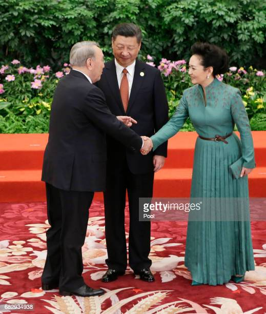 Chinese President Xi Jinping and wife Peng Liyuan welcome Kazakh President Nursultan Nazarbayev at the welcoming banquet for the Belt and Road Forum...