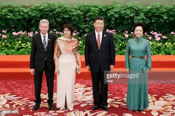 Chinese President Xi Jinping and wife Peng Liyuan welcome Swiss President Doris Leuthard and her husband Roland Hausin at the welcoming banquet for...